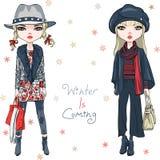 Meninas da forma do vetor na roupa do inverno ilustração royalty free