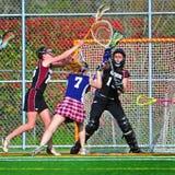 Meninas da lacrosse no movimento Fotos de Stock Royalty Free