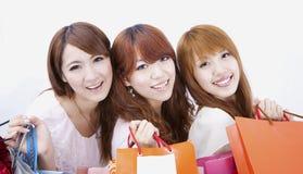 Meninas de compra felizes Imagens de Stock