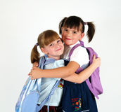 Meninas de sorriso da escola fotografia de stock