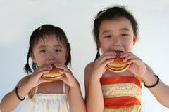 Meninas do hamburguer imagem de stock royalty free