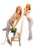 Meninas dos Gemini em capacetes alaranjados foto de stock
