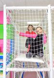 Meninas no campo de jogos Fotos de Stock Royalty Free