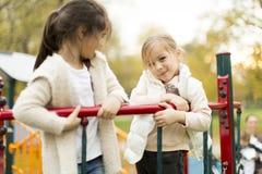 Meninas no campo de jogos Foto de Stock Royalty Free