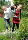 Meninas no jardim Foto de Stock Royalty Free