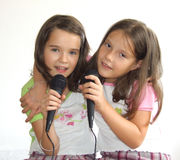 Meninas que cantam Foto de Stock