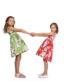 Meninas que prendem as mãos Imagens de Stock Royalty Free