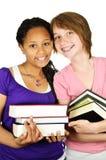Meninas que prendem livros de texto Imagem de Stock Royalty Free