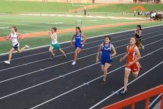 Meninas raça de 100 medidores Fotografia de Stock Royalty Free