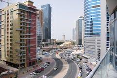 Mening aan hoge gebouwen in Doubai Stock Foto's