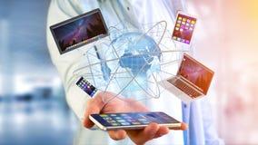 Mening van een Zakenman die een Computer en apparaten getoond o houden Stock Afbeelding