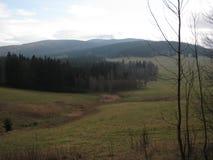 Mening van het platteland waar de verdwenen regeling Stock Afbeeldingen