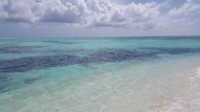 Mening van het strand in de Maldiven Stock Afbeeldingen