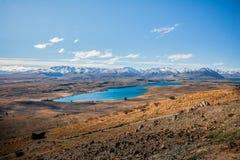 Mening van Meer Tekapo en de Zuidelijke bergketen van Alpen, Nieuw Zeeland royalty-vrije stock afbeeldingen