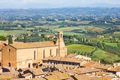 Mening van San Gimignano en het landschap in Toscanië Stock Afbeelding