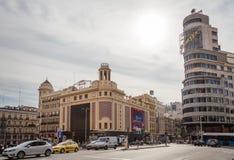 Mening van van de Capitoolbouw en Callao bioskopen in Gran via straat, stock afbeeldingen