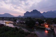 Meningsschemering het rivierlied, Laos. Royalty-vrije Stock Foto