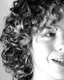 Menino adolescente com cabelo Curly Foto de Stock