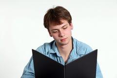 Menino adolescente com livro Fotografia de Stock Royalty Free