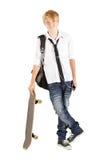 Menino adolescente com skate Fotos de Stock Royalty Free