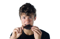 Menino adolescente confundido confundido pela disquete Foto de Stock