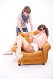 Menino adolescente e menina com um telefone Fotografia de Stock