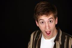 Menino adolescente surpreendido Fotos de Stock