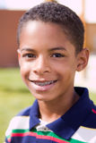 Menino afro-americano feliz com braços abertos Fotos de Stock