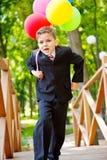 Menino alegre com balões Imagens de Stock Royalty Free