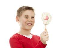 Menino alegre com pirulito Fotografia de Stock
