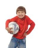 Menino alegre com uma esfera de futebol Imagem de Stock