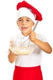 Menino alegre do cozinheiro chefe Imagem de Stock Royalty Free