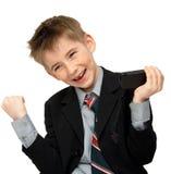 Menino alegre em um terno Fotos de Stock Royalty Free