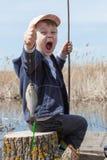 Menino ao pescar imagens de stock royalty free