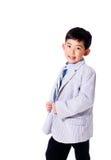 Menino asiático bonito no terno Imagens de Stock Royalty Free