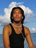 Menino asiático com earplugs Foto de Stock Royalty Free