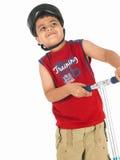 Menino asiático com seu 'trotinette' Fotos de Stock