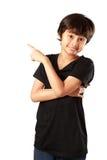 Menino asiático feliz que aponta acima Fotos de Stock