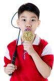 Menino asiático na ação do badminton Foto de Stock