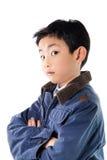 Menino asiático no levantamento do casaco azul Imagem de Stock Royalty Free