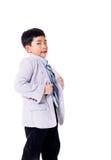 Menino asiático orgulhoso no terno Foto de Stock Royalty Free