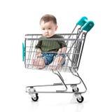 Menino asiático pequeno no carrinho de compras Imagens de Stock Royalty Free