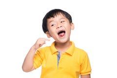 Menino asiático perdido do dente de leite, fim acima da vista fotos de stock royalty free