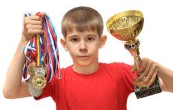 Menino-atleta com medalhas Imagens de Stock