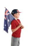 Menino australiano que prende uma bandeira. fotografia de stock