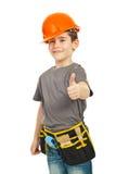 Menino bem sucedido do trabalhador que dá os polegares Imagens de Stock Royalty Free