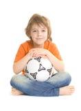 Menino bonito com esfera de futebol Fotografia de Stock