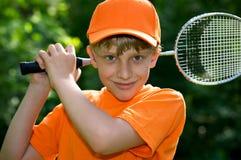 Menino bonito com raquete de badminton fotografia de stock