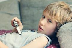 Menino bonito com telefone móvel Imagens de Stock