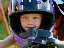 Menino bonito da criança em um capacete da motocicleta Fotografia de Stock Royalty Free